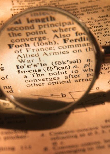 A magnifying glass on the word focus